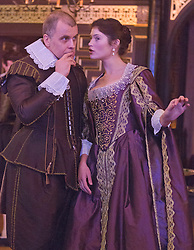 """© Licensed to London News Pictures. 14 January 2014. London, England. L-R: BRENDAN O'HEA as Pescara and GEMMA ARTERTON as The Duchess. Actress Gemma Arterton stars as the Duchess in the play """"The Duchess of Malfi"""" by John Webster. This is the first production to take place at the Sam Wanamaker Playhouse at the Globe Theatre. The performance is only lit by candles. Directed by Dominic Dromgoole. Photo credit: Bettina Strenske/LNP"""