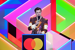 Harry Styles accepts the award for British Single during the Brit Awards 2021 at the O2 Arena, London. Picture date: Tuesday May 11, 2021.