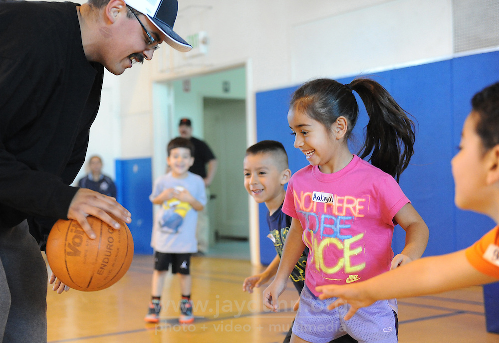 Under the tutelage of Pee Wee basketball coach Markus Garnica, left, young players Julian Garcia, 6, Aaliya Ruiz, 5, and Gael Vega, 5, practice their defensive skills during their first practice on Sunday afternoon at the Recreation Center on Lincoln Avenue in Salinas.