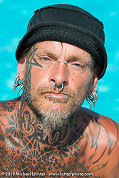 """""""Bender"""" of Gillette, WY shows off his tattoos (including his tattooed eyelids) at the Broken Spoke County Line during the annual Sturgis Black Hills Motorcycle Rally. SD, USA. August 7, 2014.  Photography ©2014 Michael Lichter."""