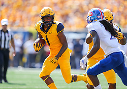 Oct 6, 2018; Morgantown, WV, USA; West Virginia Mountaineers wide receiver T.J. Simmons (1) runs the ball during the second quarter against the Kansas Jayhawks at Mountaineer Field at Milan Puskar Stadium. Mandatory Credit: Ben Queen-USA TODAY Sports