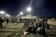 Migrants wait to get into the camp close to the Hungarian and Serbian border town of Roszke, Hungary, September 7 2015. The UN's humanitarian agencies are on the verge of bankruptcy and unable to meet the basic needs of millions of people because of the size of the refugee crisis in the Middle East, Africa and Europe, senior figures within the UN have told the media.
