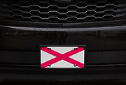 The flag of the State of Alabama on car bumper 5th March 2020 in downtown Dothan, The Peanut Capital of the World, Alabama, United States of America.
