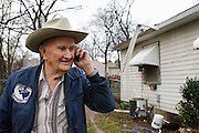 Billy J. Preston, a retired World War II US Naval Amphibious Forces, talks with his daughter on the phone about damage caused by a small tornado at his home in Dallas, Texas, on January 29, 2013.  (Stan Olszewski/The Dallas Morning News)