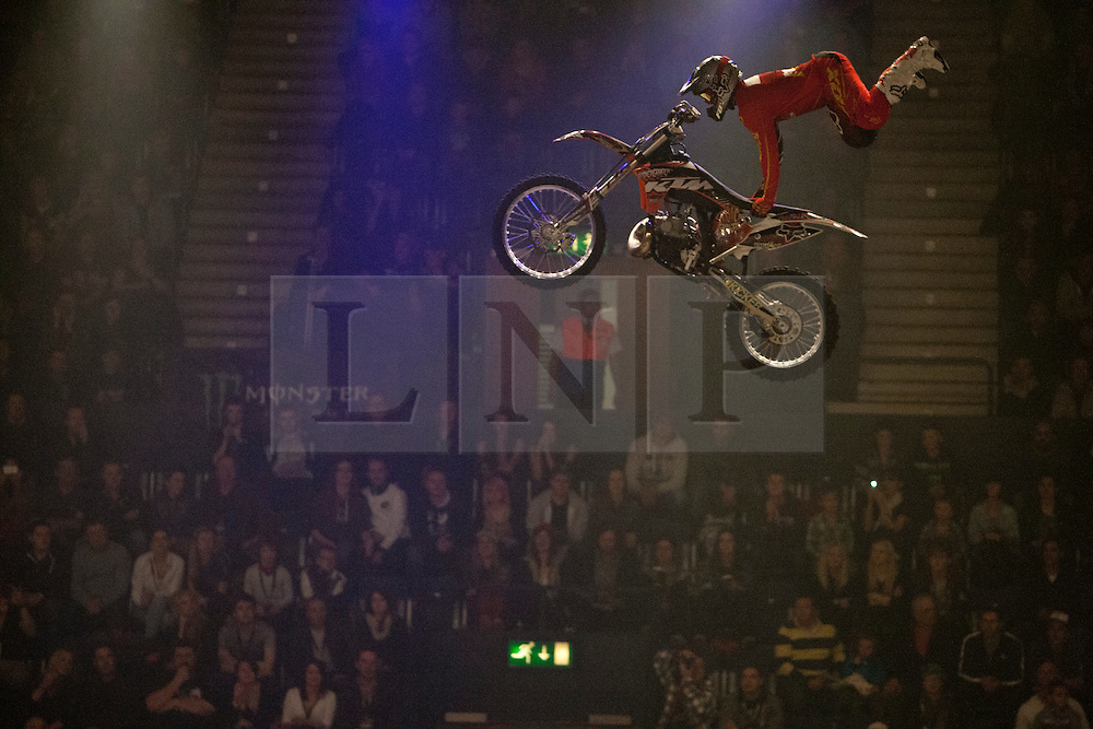 © licensed to London News Pictures. London, UK 14/03/2012. A professional motorbike rider is performing a stunt in the air as Masters of Dirt show takes place in Wembley Arena in London. Photo credit: Tolga Akmen/LNP