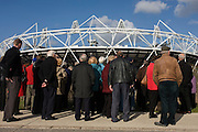 Visitors tour the Greenway, the closest viewpoint to learn about the main stadium at the 2012 Olympic Park in Stratford.