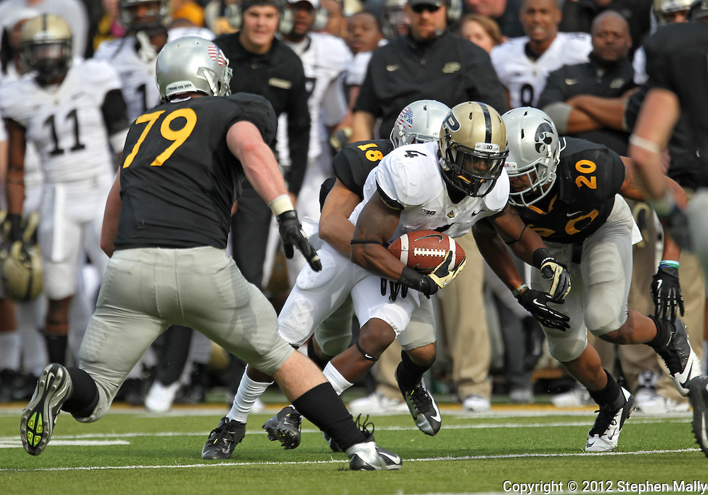 November 10 2012: Purdue Boilermakers wide receiver O.J. Ross (4) is hit by Iowa Hawkeyes cornerback Micah Hyde (18) during the NCAA football game between the Purdue Boilermakers and the Iowa Hawkeyes at Kinnick Stadium in Iowa City, Iowa on Saturday, November 10, 2012. Purdue defeated Iowa 27-24.