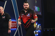 Michael Smith wins set and celebrates during the World Darts Championships 2018 at Alexandra Palace, London, United Kingdom on 27 December 2018.