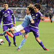 Mix Diskerud, NYCFC, is challenged by Servando Carrasco, (right), Orlando, during the New York City FC Vs Orlando City, MSL regular season football match at Yankee Stadium, The Bronx, New York,  USA. 18th March 2016. Photo Tim Clayton