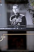 The day after the death at age 99 of Prince Phillip, the Duke of Edinburgh, consort to Queen Elizabeth II, his royal portrait is in the window of a pub near Windsor Castle where he and the Queen have been isolating throughout the Coronavirus pandemic, on 10th April 2021, in London, England.
