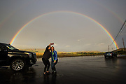 Angie Alexander, left, of Camarillo and Allison Walsh of Prescott, AZ stop to take a photo with a rainbow in the background along Read Road on Dec. 31, 2016 in Moorpark, Calif.