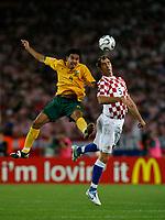 Photo: Glyn Thomas.<br />Croatia v Australia. Group F, FIFA World Cup 2006. 22/06/2006.<br /> Australia's Tim Cahill (L) and Croatia's Igor Tudor.