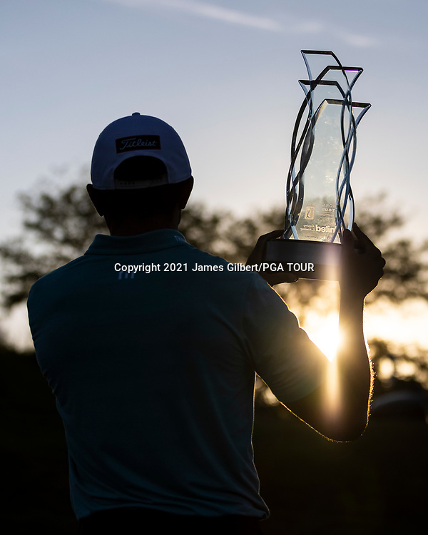 NEWBURGH, IN - SEPTEMBER 05: Joseph Bramlett poses with the Trophy on the 18th green after winning the Korn Ferry Tour Championship presented by United Leasing and Financing at Victoria National Golf Club on September 5, 2021 in Newburgh, Indiana. (Photo by James Gilbert/PGA TOUR via Getty Images)