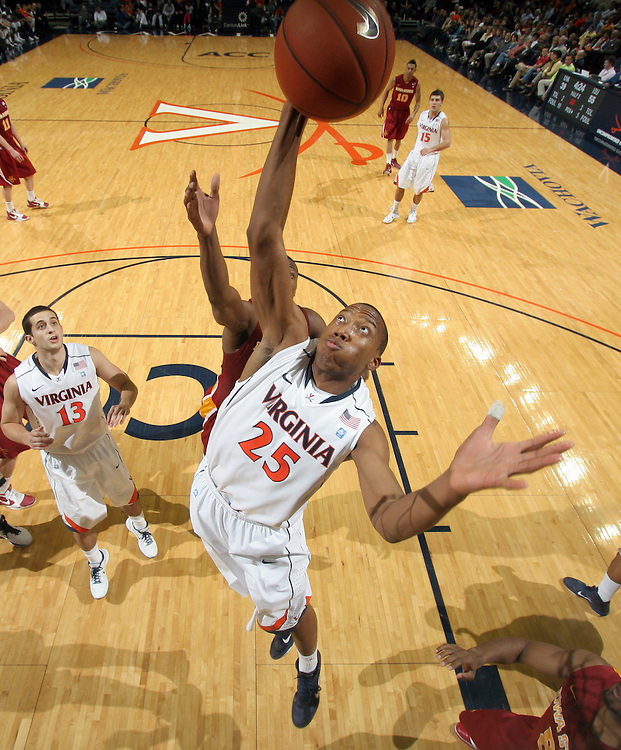 Dec. 30, 2010; Charlottesville, VA, USA; Virginia Cavaliers forward Akil Mitchell (25) grabs the rebound next to Virginia Cavaliers guard Sammy Zeglinski (13) during the game against the Iowa State Cyclones at the John Paul Jones Arena. Iowa State Cyclones won 60-47. Mandatory Credit: Andrew Shurtleff