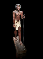 Ancient Egyptian wooden statue of Shemes,  Middle Kingdom (1980-1700 BC), tomb of Shimes, Asyut. Egyptian Museum, Turin. black background<br /> <br /> In 1908 in Asyut, Egypt an intact tomb was discovered of an official named Shemes, it contained many rich grave goods. Two rectangular Coffins, one for Shemes and the other for a woman called Rehuerausen, possibly his wife. They carry typical Middle Kingdom decorations, .<br /> <br /> If you prefer to buy from our ALAMY PHOTO LIBRARY  Collection visit : https://www.alamy.com/portfolio/paul-williams-funkystock/ancient-egyptian-art-artefacts.html  . Type -   Turin   - into the LOWER SEARCH WITHIN GALLERY box. Refine search by adding background colour, subject etc<br /> <br /> Visit our ANCIENT WORLD PHOTO COLLECTIONS for more photos to download or buy as wall art prints https://funkystock.photoshelter.com/gallery-collection/Ancient-World-Art-Antiquities-Historic-Sites-Pictures-Images-of/C00006u26yqSkDOM