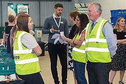 Asda Spokesperson Tim Scott chats with FareShare staff at the opening of FareShare's relocated warehouse in Ashford, Kent. Ashford, Kent, May 23 2019.