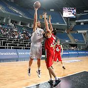 Anadolu Efes's Ermal Kurtoglu (L) during their Turkish Basketball League Play Off match Anadolu Efes between Pinar Karsiyakaat Sinan Erdem Arena in Istanbul, Turkey, Sunday, May 06, 2012. Photo by TURKPIX