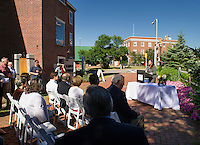 Belknap Mill President Allison Ambrose welcomes the Karigianis family, city officials and friends gathered for the dedication ceremony to honor Peter S. Karagianis on Thursday morning.  (Karen Bobotas/for the Laconia Daily Sun)