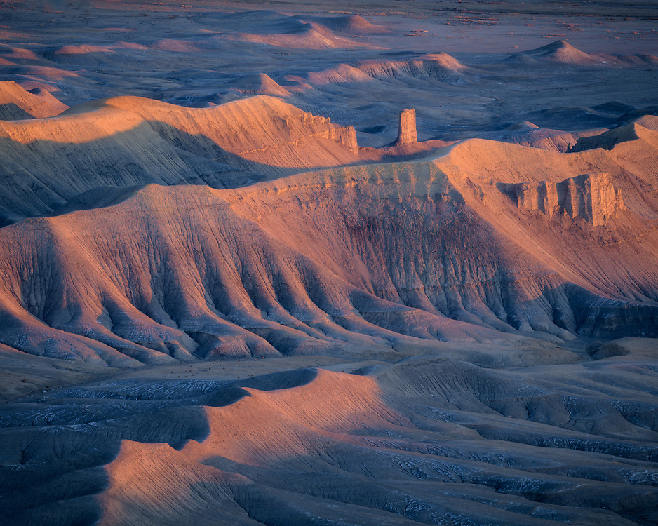 Early morning light illuminates the erroded badlands in the San Rafael Swell in Southern Utah, USA