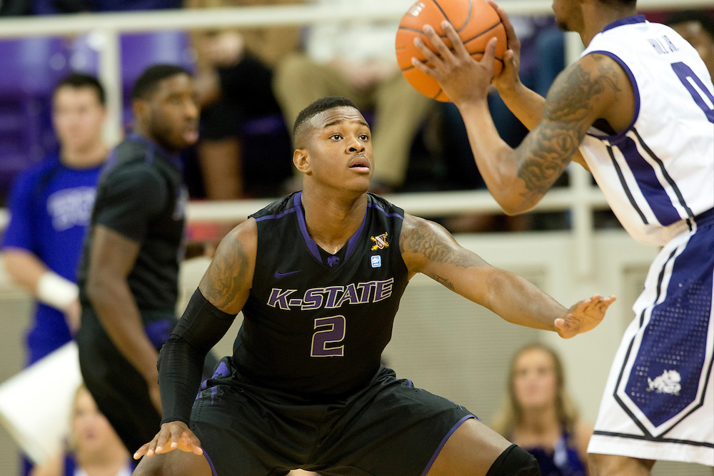 FORT WORTH, TX - JANUARY 7: Marcus Foster #2 of the Kansas State Wildcats defends Charles Hill Jr. #0 of the TCU Horned Frogs on January 7, 2014 at Daniel-Meyer Coliseum in Fort Worth, Texas.  (Photo by Cooper Neill/Getty Images) *** Local Caption *** Marcus Foster