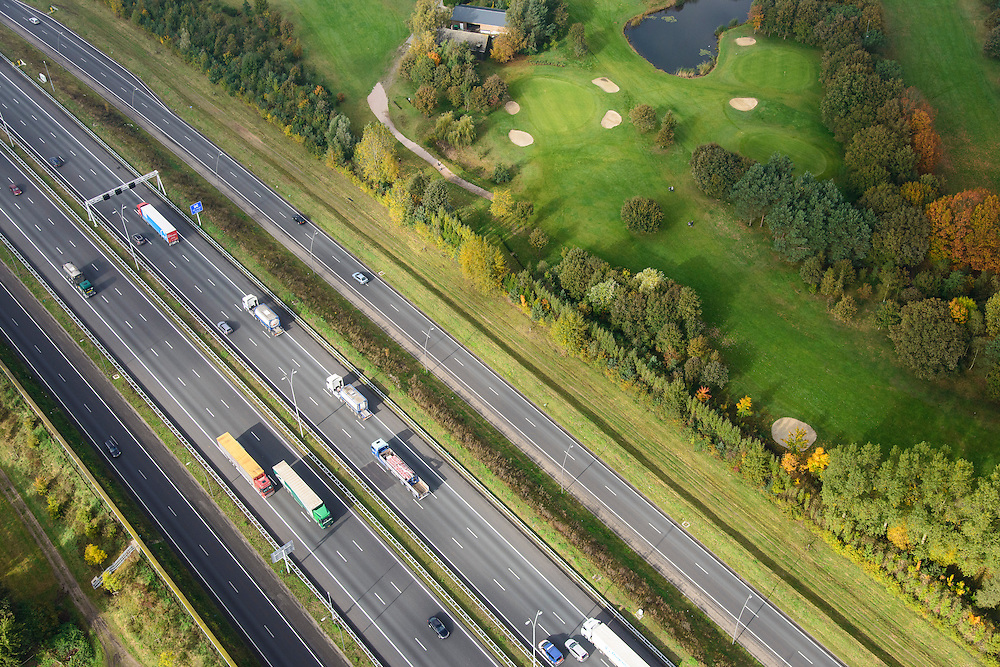 Nederland, Noord-Brabant, Eindhoven, 24-10-2013; A2 en A 67, Randweg Eindhoven, Golf & Country Club de Tongelreep.<br /> Motorway and golf course.<br /> luchtfoto (toeslag op standaard tarieven);<br /> aerial photo (additional fee required);<br /> copyright foto/photo Siebe Swart.