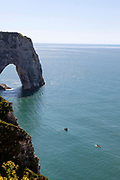Kayaying at Porte d'Aval - cliifs and arches in Etretat, Normandy, France
