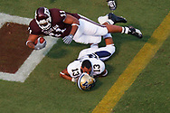 Texas A&M running back Jorvorskie Lane dives  over Montana State cornerback Kory Austin as lane scores in the second quarter on Saturday, Sept. 1, 2007. Texas A&M won the game 38-7 at Kyle Field in College Station, TX.