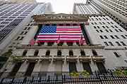 """The New York Stock Exchange (abbreviated as NYSE and nicknamed """"The Big Board""""), is an American stock exchange located at 11 Wall Street, Lower Manhattan, New York City, New York. It is by far the world's largest stock exchange by market capitalization of its listed companies at US$19.69 trillion as of May 2015. The average daily trading value was approximately US$169billion in 2013. The NYSE trading floor is located at 11 Wall Street and is composed of 21 rooms used for the facilitation of trading. A fifth trading room, located at 30 Broad Street, was closed in February 2007. The main building and the 11 Wall Street building were designated National Historic Landmarks in 1978."""
