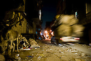 The dark streets and poorly lit reflect the neglect of the neighborhood.<br />  The Coptic community is very marginal in Cairo.