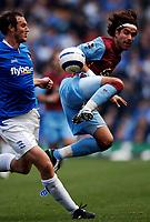 Photo: Glyn Thomas.<br />Birmingham City v Aston Villa. The Barclays Premiership.<br />16/10/2005.<br /> Villa's Juan Pablo Angel (R) goes in with an aerial challenge on Martin Taylor.