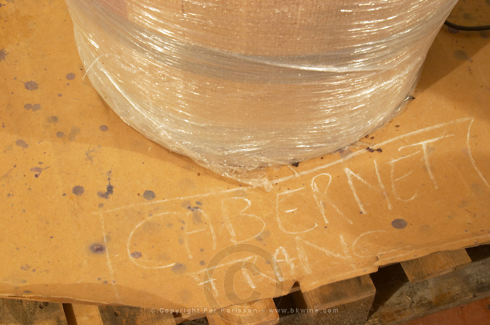 Red wine fermenting in barrels, barrel covered in bubble plastic to keep the heat better and increase extraction, marked Cabernet Franc Domaine Vignoble des Verdots Conne de Labarde Bergerac Dordogne France