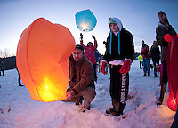 Jeff Lines and his daughter Alyson watch as their lantern fills up during the Diane Kline memorial wishes release at Moulton's Farm in Meredith Saturday evening to benefit the Diane Kline Memorial Scholarship Fund.  (Karen Bobotas/for the Laconia Daily Sun)