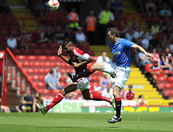 Bristol City's Liam Fontaine battles for the high ball with Glasgow Rangers' Jon Daly - Photo mandatory by-line: Joe Meredith/JMP - Tel: Mobile: 07966 386802 13/07/2013 - SPORT - FOOTBALL - Bristol -  Bristol City v Glasgow Rangers - Pre Season Friendly - Bristol - Ashton Gate Stadium