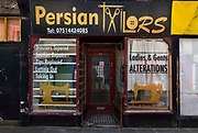Closed Persian tailors and clothing repair on 21st April 2021 in Blackpool, Lancashire, United Kingdom. Blackpool is a large town and seaside resort in the county of Lancashire on the north west coast of England. Blackpool was once a booming resort with it's famous promenade which now, despite having a somewhat shabby appearance, still continues to attract millions of visitors each year. During the coronavirus pandemic however, Blackpool has struggled, with empty streets and closed down businesses creating an atmosphere more like a ghost town.