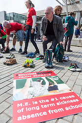 Missing Millions highlights the 21,000 people in Scotland who suffer from ME, also known as chronic fatigue system. Stuart Murdoch, lead singer of Belle and Sebastian, and author Ali Smith are supporting the campaign.<br /> <br /> Protesters stand in front of rows of empty shoes to represent people with ME missing from their lives. <br /> <br /> Pictured: Derek Crawshaw who has brought shoes to support the campaign on behalf of his daughter Eilidh Finlayson who is 18 and suffers from ME