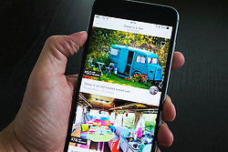 Airbnb holiday room booking app showing converted vans for rent on an iPhone 6 plus smart phone