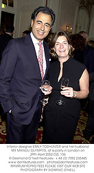 Interior designer EMILY TODHUNTER and her husband MR MANOLI OLYMPITIS, at a party in London on 29th April 2002.OZL 136