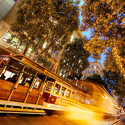 Streetcar motion blur and traffic at dusk along Powell Street near Ellis, downtown San Francisco, CA.