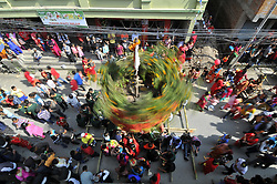 October 17, 2016 - Kathmandu, NP, Nepal - Devotees offering ritual prayer on the chariot of Lord Narayan during Lord Narayan jatra festival in Hadigaun, Kathmandu, Nepal on Monday, October 17, 2016. Once in a every year right after Dashain Festival this festival celebrates. The Narayan Jatra Festival of Hadigaun is a unique Festival in the capital involving three circular bamboo structures, above which an idol of the Lord Narayan in placed, and then rotated by two people standing below. (Credit Image: © Narayan Maharjan/NurPhoto via ZUMA Press)