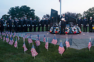 Washingtonville, N.Y. - Firefighters gather at the Washingtonville 5 Firefighters World Trade Center Memorial during a candlelight service on Sept. 11, 2017. The Memorial was built in honor of five FDNY firefighters from Washingtonville and the many others who lost their lives on September 11, 2001 in the World Trade Center terrorist attack.