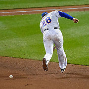 New York Mets second baseman Daniel Murphy (28) missed a ground ball hit by Kansas City Royals first baseman Eric Hosmer for a critical error during Saturday's World Series Game 4 baseball game on October 1, 2015 at Citi Field in Flushing, New York.