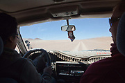 Driving a 4 x4 though the desert. Salar Uyuni salt flats and Eduardo Avaroa national park, south western Bolivia