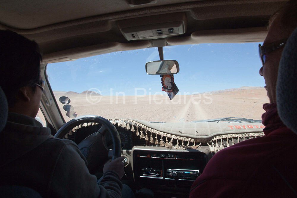 Driving a 4 x4 though the desert. Salar Uyuni salt flats and Eduardo Avaroa national park, south western Bolivia