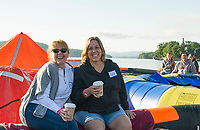 """Karen Malloy and Cindy Salta from the Bank of New Hampshire team """"rafting for wishes"""" Saturday morning for Make A Wish at Hesky Park and Meredith Bay. (Karen Bobotas/for the Laconia Daily Sun)"""