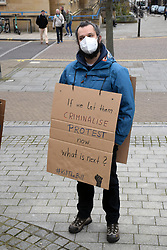 Walk for Freedom in protest at the Police, Crime, Sentencing & Courts Bill, which will restrict the democratic right to peaceful protest. This was a Covid safe walk or sit down in Norwich city centre UK organised by Extinction Rebellion. 20 March 2021