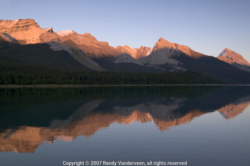 © 2007 Randy Vanderveen, all rights reserved.Jasper, Alberta.The evening sun colours the mountains surrounding Maligne Lake.