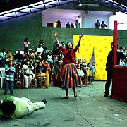 Yolanda La Amorosa celebrates her victory over her male Counterpart during the 'Titans of the Ring' wrestling group's Sunday performance at El Alto's Multifunctional Centre. Bolivia. The wrestling group includes the fighting Cholitas, a group of Indigenous Female Lucha Libra wrestlers who fight the men as well as each other for just a few dollars appearance money. El Alto, Bolivia, 14th March 2010. Photo Tim Clayton