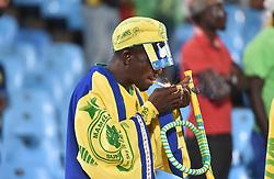 13/03/2018. Mamelodi Sundowns FC fan lights a cigarette their team during their Nedbank match at Loftus Versfeld in Pretoria.<br /> Picture: Oupa Mokoena/African News Agency/ANA