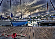 """Boats at sunset at dock with reflection and red rope in the foreground. Size suitable for framing or canvas prints up to 13 x 16"""" or any website."""