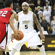 Central Florida guard Marcus Jordan (5) plays defense against Louisiana's guard Raymone Andrews (22) during their game at the UCF Arena on December 15, 2010 in Orlando, Florida. UCF won the game79-58. (AP Photo/Alex Menendez)
